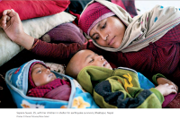 Sapana Suwal, 25, with her children in a shelter for earthquake survivors, Bhaktapur, Nepal